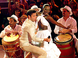 Latin singer Ricky Martin dances to a Caribbean beat as he performs at the Miss Universe Competition in Puerto Rico in 2002.  Stock/Colin Braley