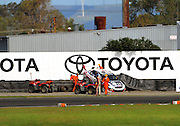 Stewards arrive after William Bamber's crash at Toyota Corner in the BNT V8s qualifying. CRC 200 MotorSport New Zealand Premier Race Championship Round 5 at Manfeild Autocourse, Feilding, New Zealand on Saturday 12 February 2011. Photo: Dave Lintott / photosport.co.nz