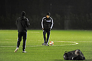Manager Garry Monk kicks the ball during Swansea city FC team training in Landore, Swansea, South Wales on Wed 19th Feb 2014. the team are training ahead of tomorrow's UEFA Europa league match against Napoli.<br /> pic by Phil Rees, Andrew Orchard sports photography.
