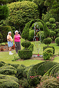Visitors stroll through Pearl Fryar Topiary Garden August 21, 2013 in Bishopville, South Carolina. Pearl Fryar without any horticultural experience turned discarded plants into an amazing topiary wonderland in his former corn field in a tiny village in rural South Carolina.