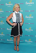 """Actress and mom Jane Krakowski at the launch of the Pampers Cruisers #SagToSwag Tour in New York, Wednesday, Aug. 12, 2015.   In celebration of the new and improved Pampers Cruisers diapers, Pampers is going on a national tour to transform the nation's babies from """"sag to swag"""" one bottom at a time.  (Photo by Diane Bondareff/Invision for Pampers/AP Images)"""