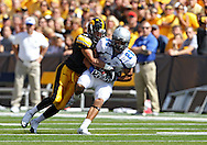 September 4 2010: Eastern Illinois Panthers wide receiver Erik Lora (22) is hit by Iowa Hawkeyes cornerback Greg Castillo (2) after a receiption during the first quarter of the NCAA football game between the Eastern Illinois Panthers and the Iowa Hawkeyes at Kinnick Stadium in Iowa City, Iowa on Saturday September 4, 2010. Iowa defeated Eastern Illinois 37-7.
