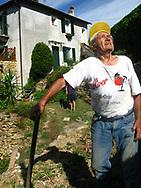 Man digging onions on a farm near Finale Ligure Liguria Italia