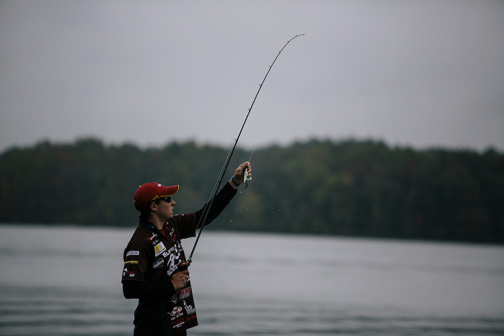 Billy Hines of Slippery Rock University, fixes his lure as he fishes for bass during the FLW College Fishing Northern Conference Invitational in Marbury, MD on Oct. 11, 2014. Only the top 15 of 43 teams moved on to Sunday.