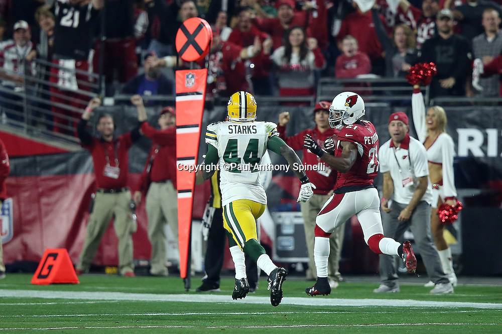 Arizona Cardinals cornerback Patrick Peterson (21) is chased by Green Bay Packers running back James Starks (44) as he returns a second quarter for an apparent touchdown negated by a second quarter penalty during the NFL NFC Divisional round playoff football game against the Green Bay Packers on Saturday, Jan. 16, 2016 in Glendale, Ariz. The Cardinals won the game in overtime 26-20. (©Paul Anthony Spinelli)