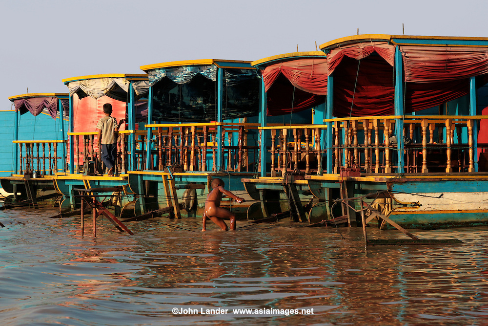 The Tonle Sap is a combined lake and river system of huge importance to Cambodia.The area is home to many ethnic Vietnamese and numerous Cham communities living in floating villages around the lake. The Tonle Sap is the largest freshwater lake in Southeast Asia and is an ecological hot spot that was designated as a UNESCO biosphere in 1997.  For most of the year the lake is fairly small, around one meter deep and with an area of 2,700 square km. During the monsoon season, however, the Tonlé Sap river, which connects the lake with the Mekong river, reverses its flow. Water is pushed up from the Mekong into the lake, increasing its area to 16,000 square km and its depth to up to nine meters, flooding nearby fields and forests. The floodplain provides a perfect breeding ground for fish.