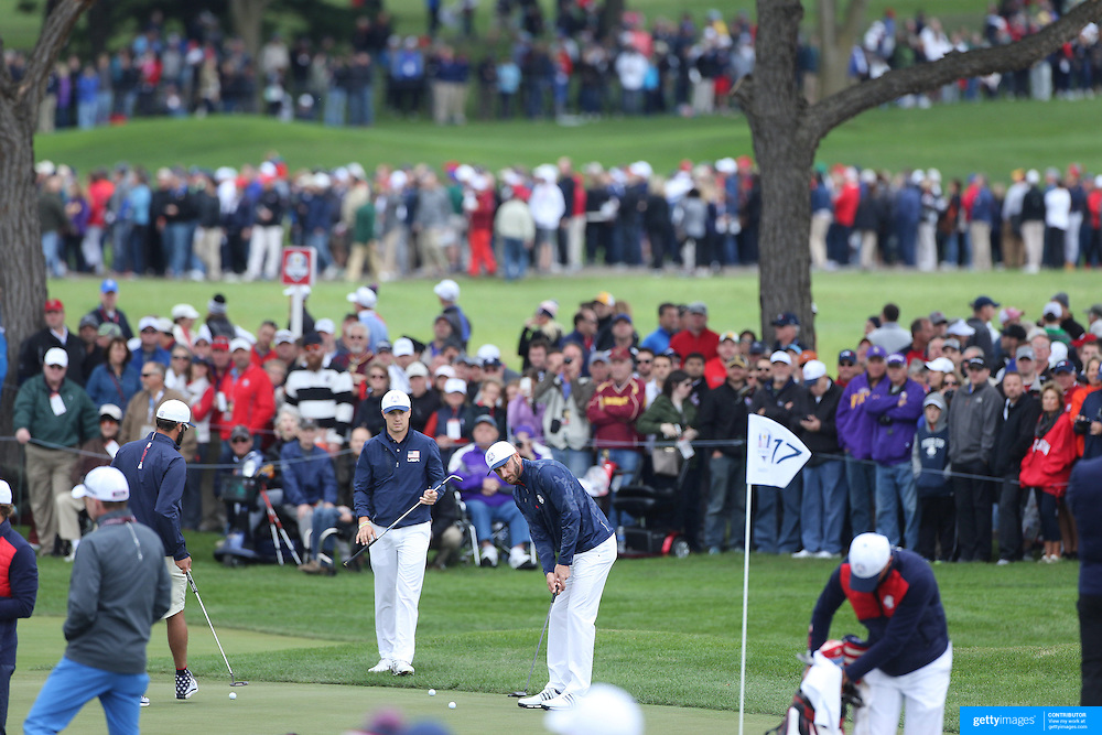 Ryder Cup 2016. Dustin Johnson and Jordan Spieth of the United States practices on the 17th green during practice day in front of massive crowds at the Hazeltine National Golf Club on September 28, 2016 in Chaska, Minnesota.  (Photo by Tim Clayton/Corbis via Getty Images)