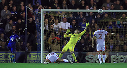 AFC Wimbledon's Adedeji Oshilaja watches his shot hit the crossbar as Milton Keynes Dons' goalkeeper Lee Nicholls struggles to dive for it