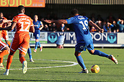 AFC Wimbledon midfielder Tom Soares (19) with a shot on goal during the EFL Sky Bet League 1 match between AFC Wimbledon and Shrewsbury Town at the Cherry Red Records Stadium, Kingston, England on 3 November 2018.