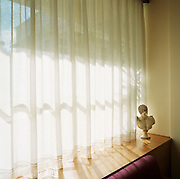 Standing in the corner of a brightly sun-lit window, a classical reproduction bust is seen in a hotel foyer in the modern town of Olympia, the birthplace of athletics and the Olympic ideal. Amid the woodland of ancient Olympia where for 1,100 continuous years, the ancients held their pagan festival of sport and debauchery. The modern games share many characteristics with its ancient counterpart. Corruption, politics and cheating interfered then as it does now and the 2004 Athens Olympiad echoed both what was great and horrid about the past.