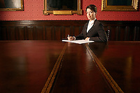 Woman in Conference Room sitting