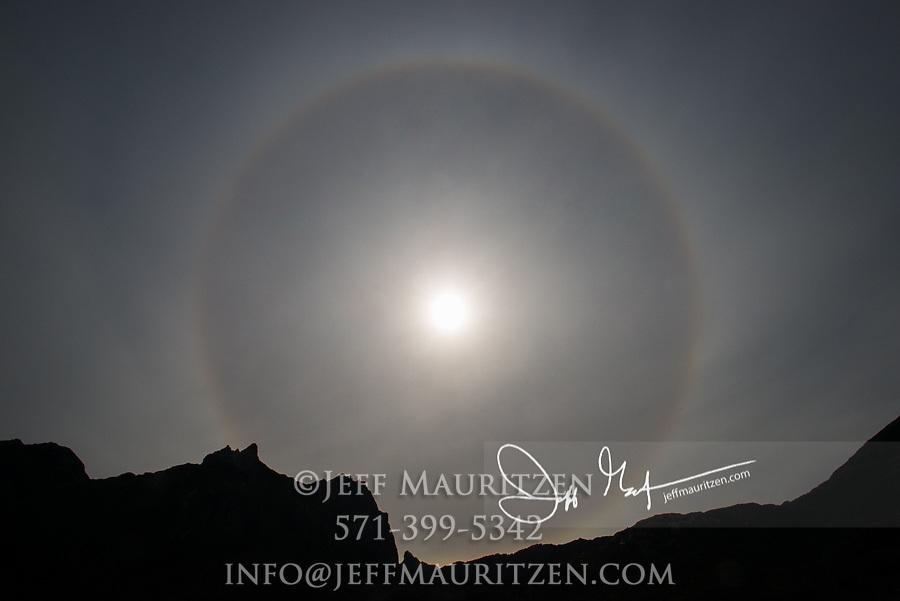A circular sun halo (22 degree halo) seen above the mountains of Isla de Los Estados, Argentina.
