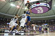 FORT WORTH, TX - FEBRUARY 6: Perry Ellis #34 of the Kansas Jayhawks drives to the basket against the TCU Horned Frogs on February 6, 2016 at the Ed and Rae Schollmaier Arena in Fort Worth, Texas.  (Photo by Cooper Neill/Getty Images) *** Local Caption *** Perry Ellis