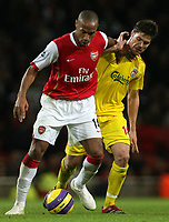 Photo: Paul Thomas.<br /> Arsenal v Liverpool. The Barclays Premiership. 12/11/2006.<br /> <br /> Thierry Henry (14) of Arsenal pushes off Axbi Alonso.