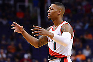 Nov 2, 2016; Phoenix, AZ, USA; Portland Trail Blazers guard Damian Lillard (0) reacts on the court during the first half of the NBA game against the Phoenix Suns at Talking Stick Resort Arena. The Suns defeated the Trail Blazers 118-115 in overtime. Mandatory Credit: Jennifer Stewart-USA TODAY Sports