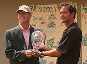 2007 Boyne Tournament of Champions winner Michael Harris accepts the tournaments crystal trophy from Boyne Resorts director of eastern operations Steve Kircher.