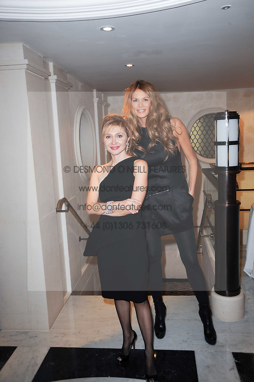 Left to right, SILVIA DAMIANI and ELLE MACPHERSON at a dinner hosted by jewellers Damiani at The Connaught Hotel, London on 3rd February 2010.