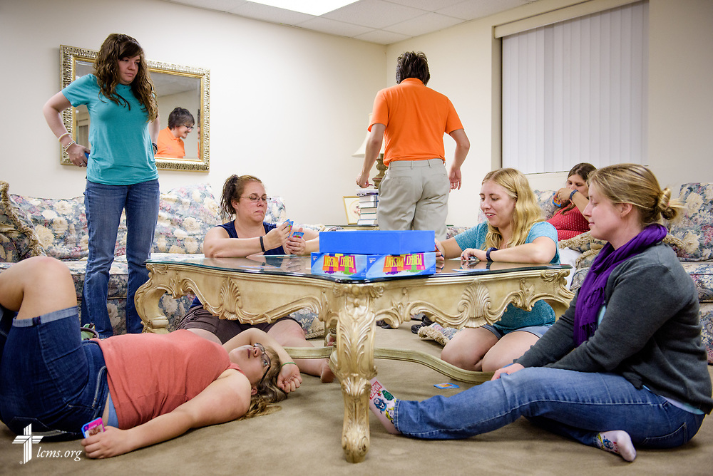 Joanna Johnson (third from right, at table), new GEO missionary to Taiwan, spends time with her family and friends for a late evening game night at St. John's Lutheran Church, Conover, N.C, on Friday, April 21, 2017, in Conover. Johnson said she'll miss time with her family and events with friends once she leaves as a missionary overseas. Pictured with Joanna are, from left to right, Mary Johnson, Elizabeth Probst, Deb Bradtmueller, Michael Zastrow, Suzanne Zastrow, and Dr. Sarah Nelson. LCMS Communications/Erik M. Lunsford