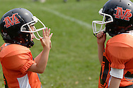 Middletown, NY - Two Marlboro players talk on the sideline during an Orange County Youth Football League game against Middletown at Watts Park  on  Sept. 9, 2007.