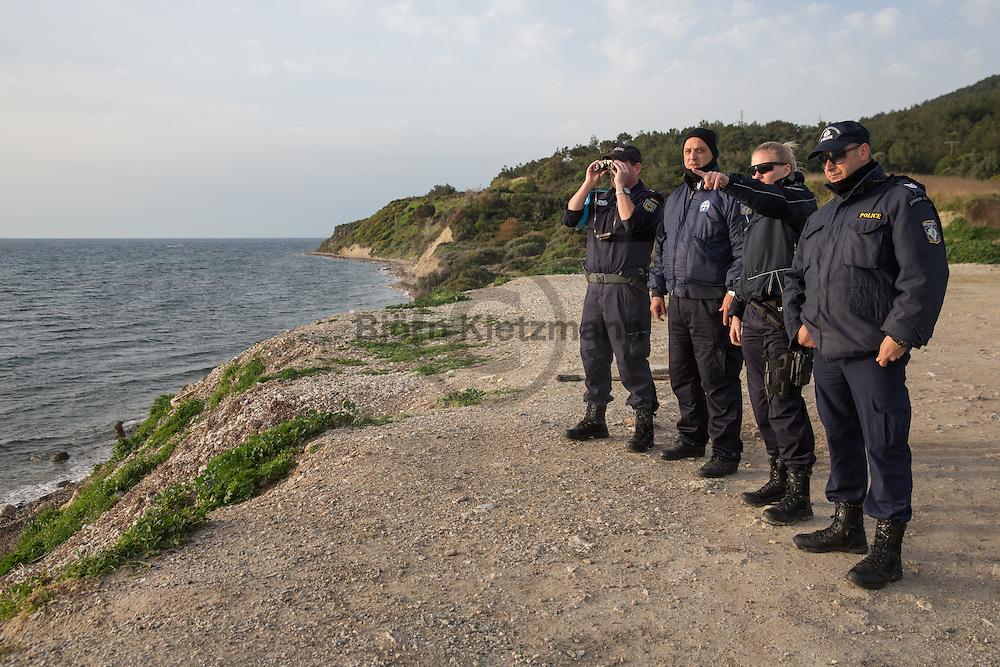 Mytilene, Lesvos, Greece - 08.03.2016      <br /> <br /> German Frontex police officers and their Greek colleagues searching with binoculars for arriving refugee boats on the coast of Lesvos.<br />  <br /> Deutsche Bundespolizisten im Frontex-Einsatz und ihre griechischen Polizei-Kollegen suchen an der Kueste von Lesbos mit Ferngl&auml;sern nach Fluechtlingsbooten.<br /> <br /> Foto: Bjoern Kietzmann