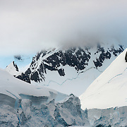 Some of the scenic mountains covered in ice and snow that line the famous Lemaire Channel along the western side of the Antarctic Peninsula.