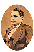 Portrait of Pomare V, 1839-91, last King of Tahiti, ruled 1877-80, photograph by Hoare Studio, taken before 1891, in the MTI-TFM Collection (fonds de la Polynesie Francaise), in the Musee de Tahiti et des Iles, or Te Fare Manaha, at Punaauia, on the island of Tahiti, in the Windward Islands, Society Islands, French Polynesia. The Museum of Tahiti and the Islands was opened in 1974 and displays collections of nature and anthropology, habitations and artefacts, social and religious life and the history of French Polynesia. Picture by Manuel Cohen