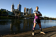 Melbourne Storm NRL player Greg Inglis on the banks of the Yarra River with Melbourne CBD in background.