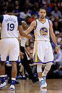 Feb 10, 2016; Phoenix, AZ, USA; Golden State Warriors guard Stephen Curry (30) high fives guard Leandro Barbosa (19) on the court during the game against the Phoenix Suns at Talking Stick Resort Arena. Mandatory Credit: Jennifer Stewart-USA TODAY Sports