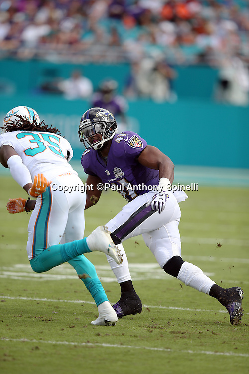 Baltimore Ravens cornerback Anthony Levine (41) covers Miami Dolphins free safety Walt Aikens (35) on special teams punt coverage during the 2015 week 13 regular season NFL football game against the Miami Dolphins on Sunday, Dec. 6, 2015 in Miami Gardens, Fla. The Dolphins won the game 15-13. (©Paul Anthony Spinelli)