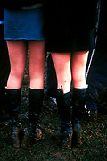 Two women in high muddy boots and skirts, U.K, 1990s.
