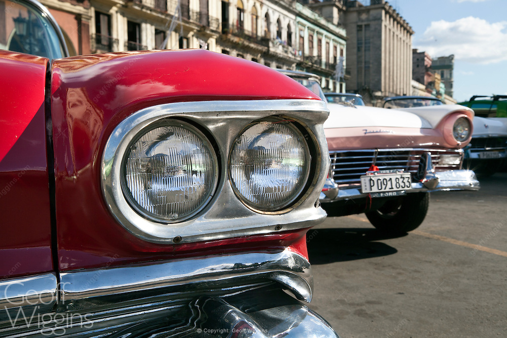Line up of US automobiles from the pre-embargo age on the Paseo de Marti, Havana, Cuba