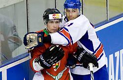 TOKAJI Viktor of Hungary  vs Ashley Tait of Great Britain at IIHF Ice-hockey World Championships Division I Group B match between National teams of Great Britain and Hungary, on April 21, 2010, in Tivoli hall, Ljubljana, Slovenia.  (Photo by Vid Ponikvar / Sportida)