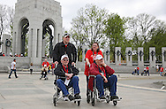 Korea War Veterans Lester Cherry and William Shafer (front from left) both of Winthrop are pushed around by Kendrick Long and Marilyn Crow  (back from left) also both of Winthrop during the Sullivan-Hartogh-Davis Post 730 Honor Flight at the National World War II Memorial in Washington, DC on Tuesday, April 16, 2013. About 90 veterans were on the trip. After their visit to the National World War II Memorial they would take a bus tour of Washington, DC followed by a visit to the Korean War Veterans Memorial.