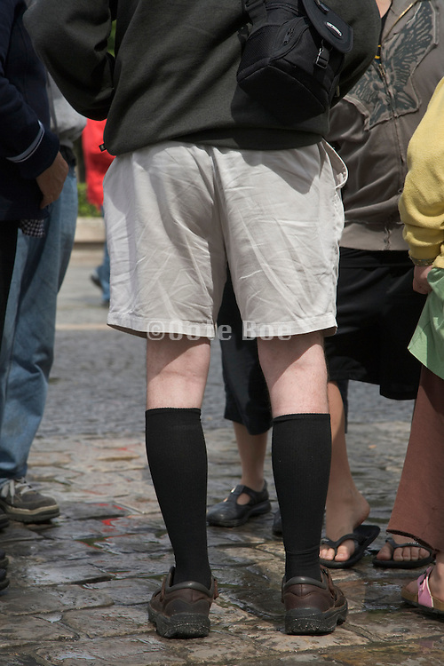 senior man with shorts and long black socks