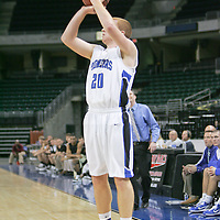 Guard Jake Lowensein (20) scores a three point shot.