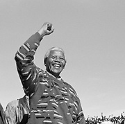 Nelson Mandela raises his fist to a crowd of supporters at the Athlone Stadium whilst on the election campaign trail prior to the first democratic elections in South Africa 1994.<br /> <br /> Photograph &copy; nic bothma