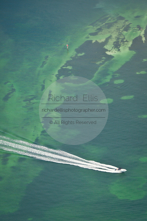 Aerial of a boat on green water Key West, Florida.