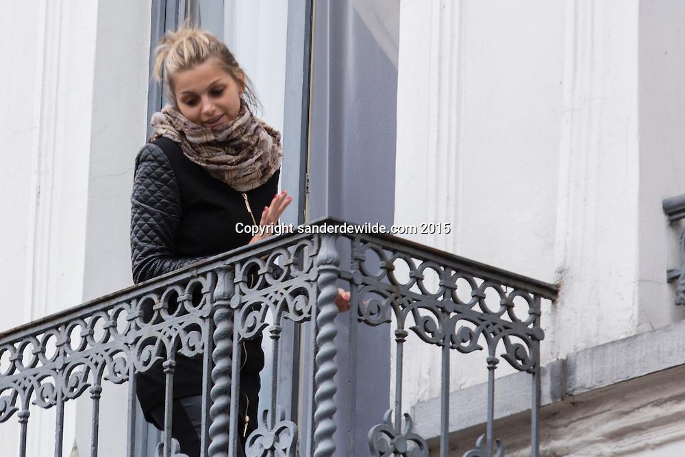 2015 november 16. Brussels, Belgium, Sint Jans Molenbeek.familymember of the Adeslam family looks at the door from the balcony