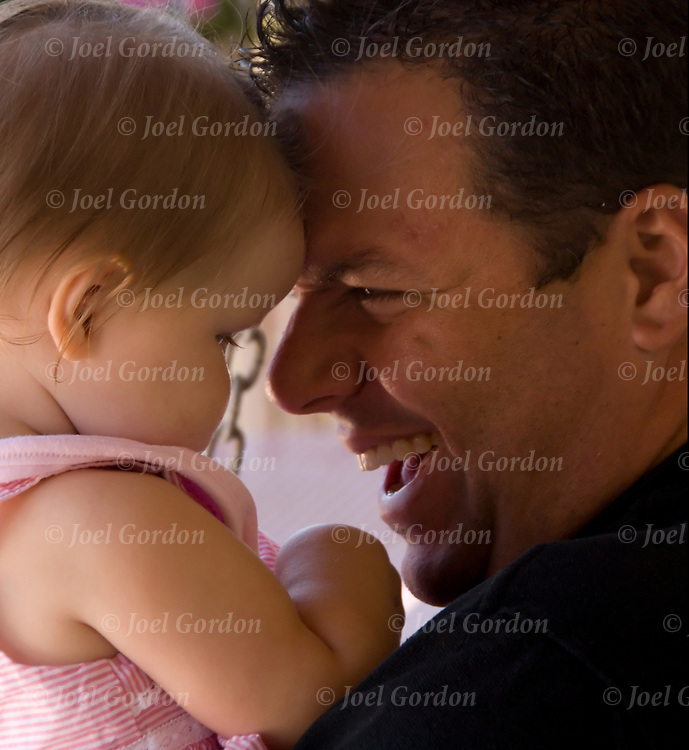 Portrait of father playing with his 8 month old daughter.<br /> <br /> release #2459