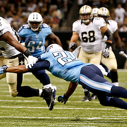 Aug 15, 2014; New Orleans, LA, USA; New Orleans Saints running back Mark Ingram (22) breaks a tackle by Tennessee Titans free safety George Wilson (21) on a touchdown reception during second quarter of a preseason game at Mercedes-Benz Superdome. Mandatory Credit: Derick E. Hingle-USA TODAY Sports