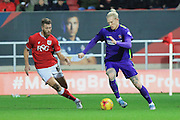 Charlton Athletic forward Simon Makienok and Bristol City defender Nathan Baker during the Sky Bet Championship match between Bristol City and Charlton Athletic at Ashton Gate, Bristol, England on 26 December 2015. Photo by Jemma Phillips.