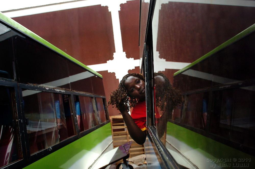 A woman leans out the window of a bus in Kampala, Uganda, October 4, 2006...Photo by Erin Lubin