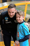 Derby County striker Andreas Weimann poses with a fan during the Sky Bet Championship match between Wolverhampton Wanderers and Derby County at Molineux, Wolverhampton, England on 27 February 2016. Photo by Alan Franklin.