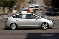 SAN FRANCISCO - SEPTEMBER 1: A potential hybrid car buyer test drives a Toyota Prius on September 1, 2005 in San Francisco, California. WIth gas prices rising and tax incentives motorists are starting to turn to alternative means to fuel their vehicles.  (Photograph by David Paul Morris)