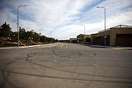 Tire skid marks cover an intersection between a housing development, left, and Porter Ranch Community School, right, as methane gas leaks from the SoCalGas Aliso Canyon Storage Facility well SS-25 in the Porter Ranch neighborhood of Los Angeles, California on Sunday, January 3, 2016. The Aliso Canyon gas leak (also called Porter Ranch gas leak) was a massive natural gas leak that started on October 23, 2015. According to Wikipedia, an estimated 1,000,000 barrels per day was released from a well within the underground storage facility in the Santa Susana Mountains near Porter Ranch. The second-largest gas storage facility it belongs to the Southern California Gas Company (SoCalGas), a subsidiary of Sempra Energy. On Jan. 6, 2016, Governor Jerry Brown issued a State of Emergency. The Aliso gas leak carbon footprint is said to be larger than the Deepwater Horizon leak in the Gulf of Mexico. On Feb. 11, 2016 the gas company reported that it had the leak under control. On Feb. 18 state officials announced that the leak was permanently plugged. An estimated 97,100 tonnes of methane and 7,300 tonnes of ethane was released into the atmosphere, making it the worst natural gas leak in U.S. history in terms of its environmental impact. © 2016 Patrick T. Fallon