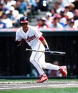 CHICAGO - UNDATED:  Omar Vizquel of the Cleveland Indians bunts during an MLB game at Jacobs Field in Cleveland, Ohio.  Vizquel played for the Indians from 1994-2004.  (Photo by Ron Vesely)