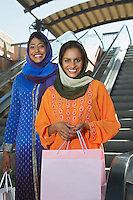 Portrait of two muslim women with shopping bags