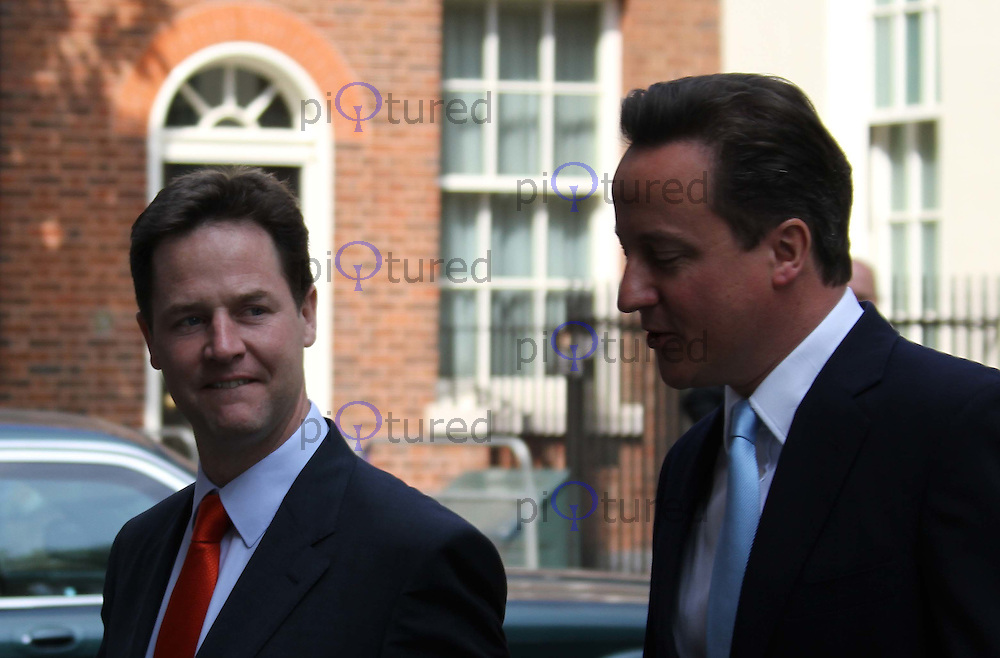 London, UK, 25 May 2010: Deputy Prime Minister Nick Clegg and Prime Minister David Cameron leaving 10 Downing Street for the State Opening of Parliament at the House of Commons. For piQtured Sales contact: Ian@Piqtured.com +44(0)791 626 2580 (Picture by Richard Goldschmidt/Piqtured)