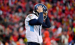 Jan 19, 2020; Kansas City, Missouri, USA; Tennessee Titans quarterback Ryan Tannehill (17) reacts after a turnover on downs during the AFC Championship Game against the Kansas City Chiefs at Arrowhead Stadium. Mandatory Credit: Denny Medley-USA TODAY Sports