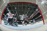 KELOWNA, CANADA - JANUARY 18: Thomas Foster #61 of the Moose Jaw Warriors checks Gordie Ballhorn #4 in front of the net of Michael Herringer #30 of the Kelowna Rockets on January 18, 2017 at Prospera Place in Kelowna, British Columbia, Canada.  (Photo by Marissa Baecker/Shoot the Breeze)  *** Local Caption ***
